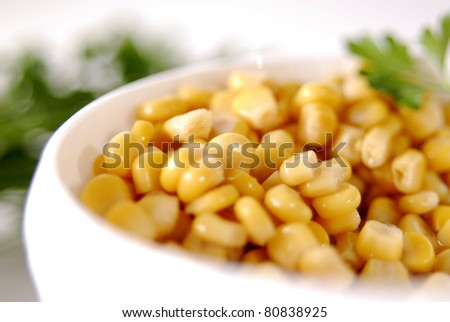 Yellow corn grains on a dish - stock photo