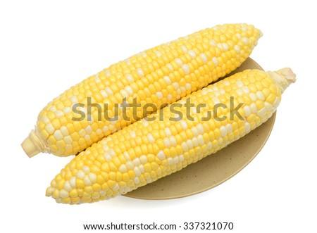 yellow corns on plate isolated on white