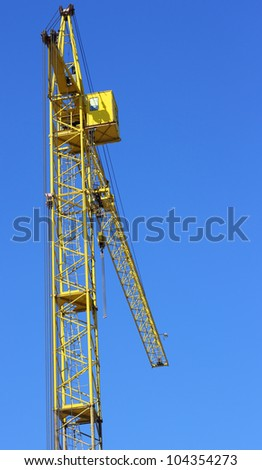 yellow crane and blue sky on building site