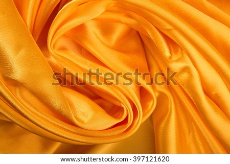 Yellow crumpled cloth as a background.