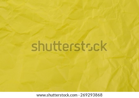 Yellow crumpled paper for texture or backgro - stock photo