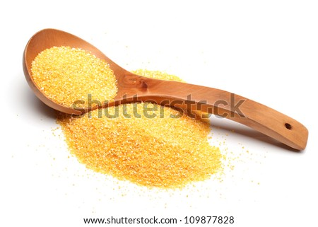 Yellow crushed maize cereals on white background - stock photo