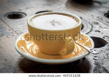 Yellow Cup of Cappuccino Coffee