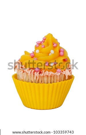 yellow cupcake with whipped cream and pink baby girl rusk