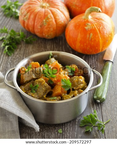 Yellow curry with pumpkin and pork.