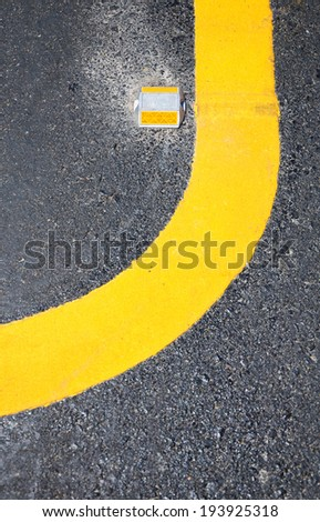 yellow curve on the road. - stock photo