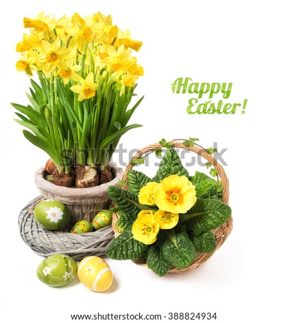 """Yellow daffodils and primrose on white background, space for your text. Caption """"Happy Easter"""" with leaves. - stock photo"""