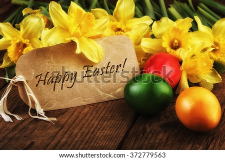 Yellow daffodils flowers text Happy Easter card sunlight effect