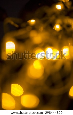 yellow, dark and red background with christmas lights in boken - stock photo