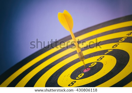 Yellow dart with target arrows ,business concept of target marketing. Success or Goal symbol. - stock photo