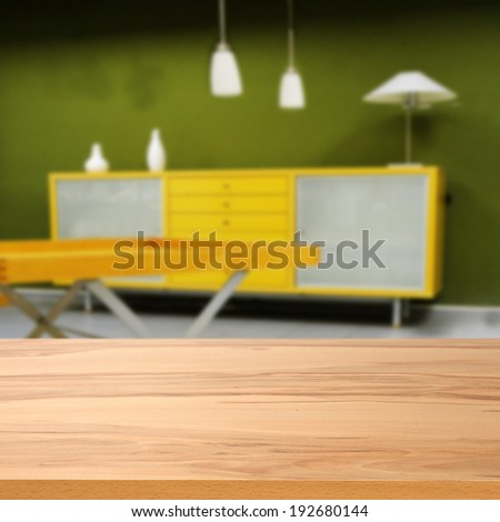 yellow desk and green wall  - stock photo