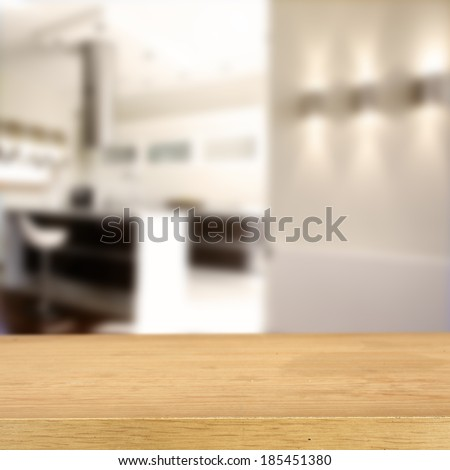 yellow desk of free space and kitchen background  - stock photo