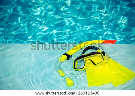Yellow diving goggles, snorkel and flippers. Summer vacation concept