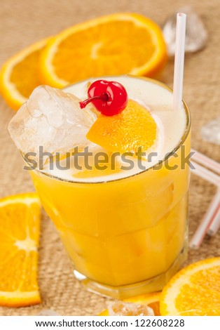 Yellow drink with lemon and orange