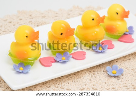 yellow duck jelly in white dish, delicious dessert - stock photo