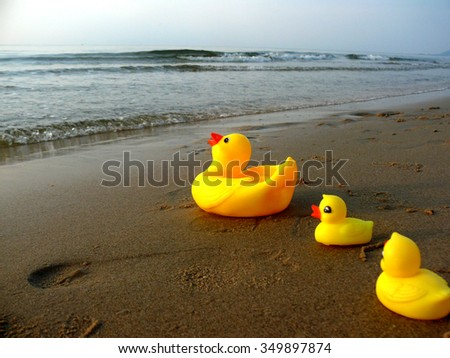 Yellow duck/Rubber Duck/Duck Toys/Duck on the beach - stock photo