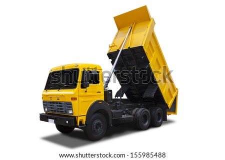 Yellow dump truck with shadow isolated on white background - stock photo