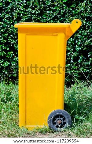 Yellow dumpster - stock photo