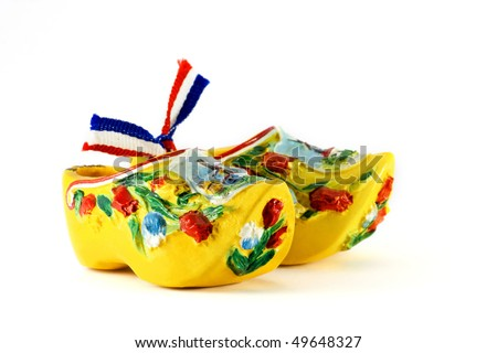 Yellow Dutch shoes isolated on white - stock photo