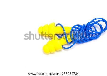 Yellow earplugs with blue band  - stock photo