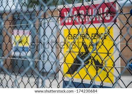 Yellow electric fence sign