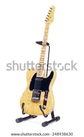 yellow electric guitar on stand, isolated on white background - stock photo
