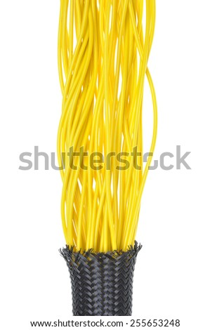 Yellow electrical wires in protection tube on white background - stock photo