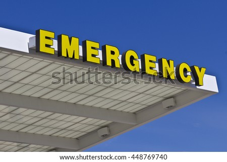 Yellow Emergency Entrance Sign for a Local Hospital VIII - stock photo