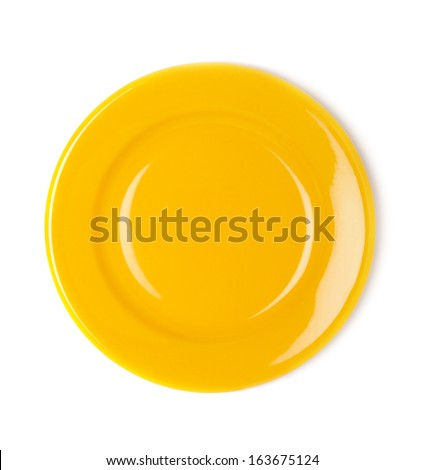 Yellow empty plate on white background - stock photo
