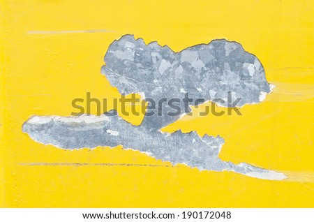 yellow enameled paint cracking and showing inner metal - stock photo