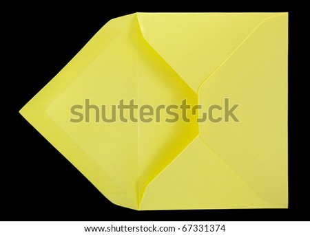Yellow envelope isolated on the black surface. - stock photo