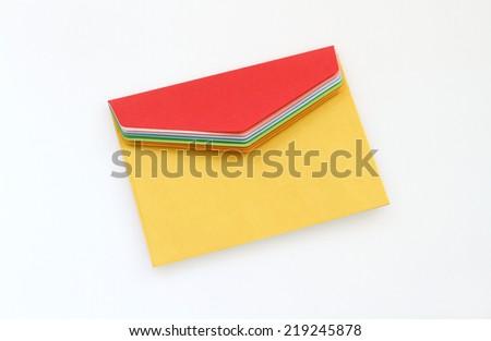 Yellow envelope on white background - stock photo