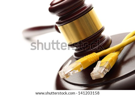 Yellow ethernet cable and wooden gavel - stock photo