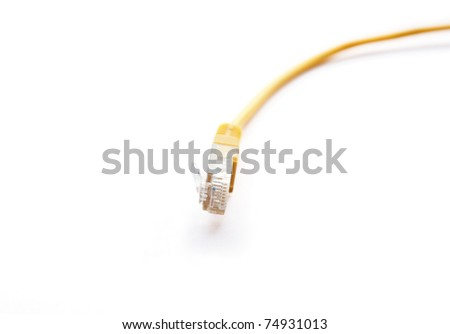 Yellow ethernet cable. Closeup network wire isolated on white