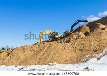 Yellow excavator at work  - stock photo