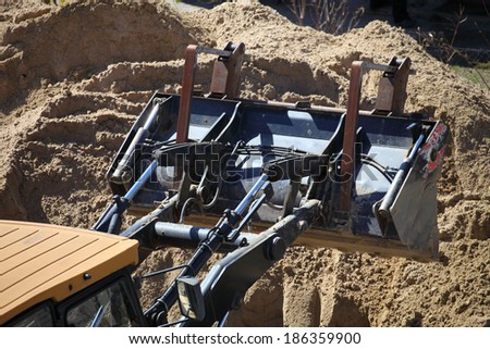 Yellow excavator on the construction site - stock photo