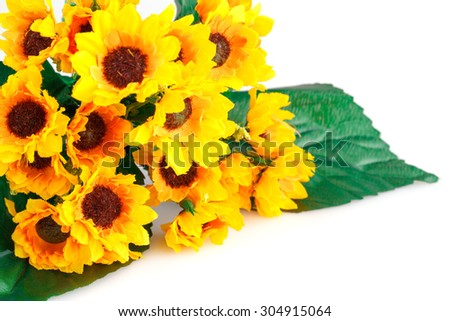 Yellow fabric flowers isolated on white background.