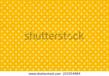 Yellow fabric with white polka dots - stock photo
