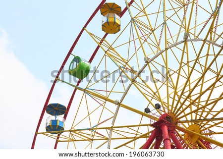 Yellow ferris wheel on blue sky  - stock photo