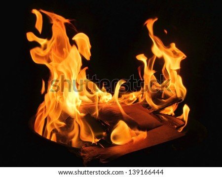 Yellow fire plasma on black background - stock photo