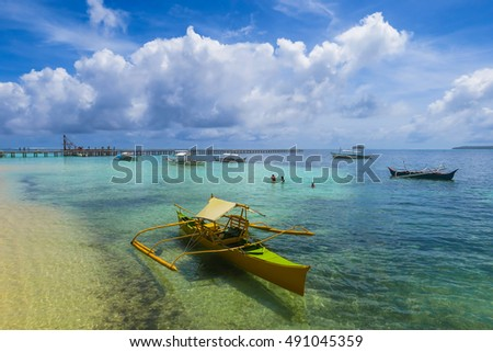 Yellow Fishing Boat In A Tropical Island Harbor