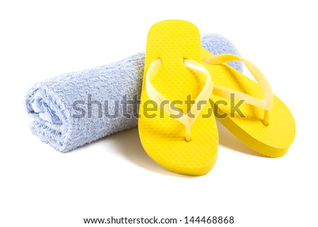 yellow flip flop shoes and towel isolated on white background - stock photo