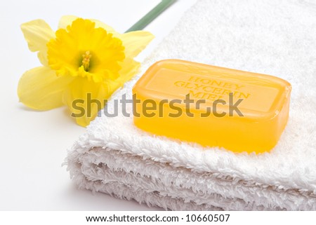yellow flower and soap on the towel - stock photo