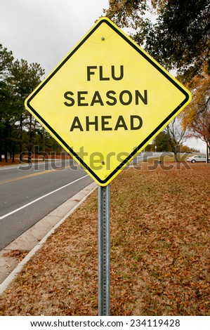 Yellow flu season ahead highway road sign - stock photo