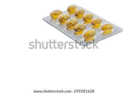 Yellow food supplement tablet with white background - stock photo