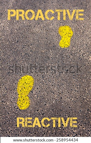 Yellow footsteps on sidewalk from Reactive to Proactive message. Concept image - stock photo
