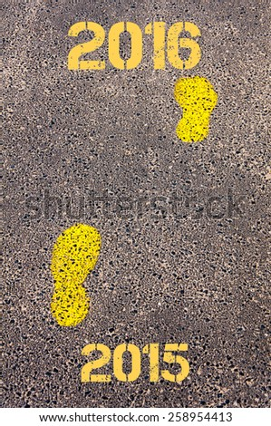 Yellow footsteps on sidewalk from Year 2015  to Year 2016 messages.New Years Conceptual image