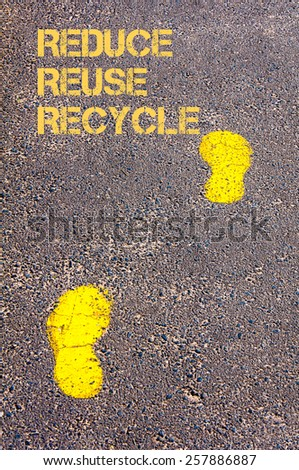 Yellow footsteps on sidewalk.Reduce Reuse Recycle message.Concept image