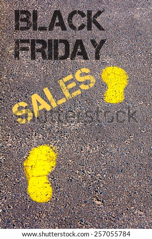 Yellow footsteps on sidewalk towards Black Friday Sales message.Retail sales Conceptual image