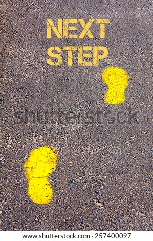 Yellow footsteps on sidewalk towards Next Step message.Conceptual image